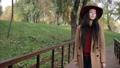 Gorgeous woman enjoying leisure in autumn park 35352660