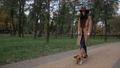 Joyful girl playing with her dog in public park 35352933