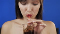 Woman drinking a glass of cola with ice. Make 35388812
