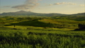 Tuscany at sunset with farm house and hills 35649588