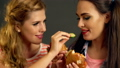 Burger women eating fast food with ham . 35941745