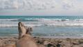 Legs of Men Lying on Beach near the Sea, POV 35962297