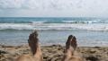 Legs of Man Lying on Beach near the Sea, POV. Slow 35962426