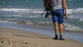 Feet of Fisherman with fishing rods and a backpack 35962505