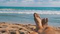Legs of Men Lying on Beach near the Sea, POV. Slow 35963874