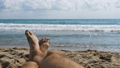 Legs of Men Lying on Beach near the Sea, POV. Slow 35963878