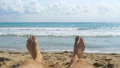 Legs of Man Lying on Beach near the Sea, POV 35963954