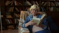 Delighted senior lady reading a book at home 36795436