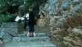 Woman standing on his head on stone steps on 37044412