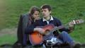 Beautiful young couple enjoy playing guitar in 37336714