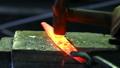 Shaping of metal part in blacksmith workshop 37397533