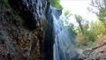 a small waterfall breaks from the stones 37499347