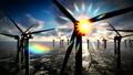 Dusk skies over windmill offshore turbines farm 37512929