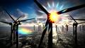 Dusk skies over windmill offshore turbines farm 37516597