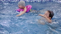 Children's water games in the pool. Little kids 37707363