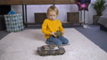 Serious boy learning to play remote control toy 37737603