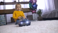 Cute boy playing with remote control toy at home 37737628