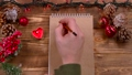 Man's hand writes a New Year's message to Santa 37779398