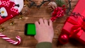 Man's hand puts the phone on the table, garlands 37779402