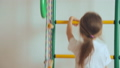 Young girl climbing up and down gymnastic complex 37818868