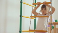 Young girl climbing up and down gymnastic complex 37818869