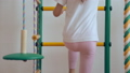 Young girl climbing up and down gymnastic complex 37818872