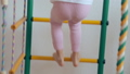 Young girl climbing up and down gymnastic complex 37818873