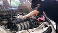 Asian mechanic man maintenance car engine valve. 37855718