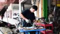 Asian mechanic man maintenance car engine valve. 37855719