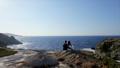 Young romantic couple is enjoying beautiful sunset 37955789