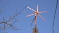 Wind Turbine Start Rotation, Green Energy on Blue 38141887
