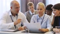 business people discussing papers at conference 38152188