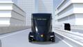 黑色自動駕駛電動卡車行駛平行於高速公路 38186561