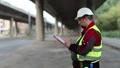 Road mender makes notes in work documentation 38463090