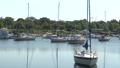 Sailboats moored with flag in the background 38773154