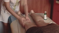 Young woman having feet massage in beauty spa 38776501