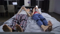 Couple lying in bed with mobile phones in hands 39250565