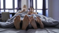 Close-up bare feet of young couple under blanket 39251227