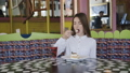 Happy girl eats dessert, looks at camera and 39310925