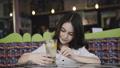 Pretty girl admiring of lemonade's serving in cafe 39310932