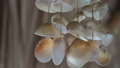 Wind chime sea shells on blur background 39494218
