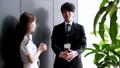 壁際で会話する男性と女性(ビジネスイメージ) 39504341
