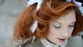 Beautiful red-haired girl in a hat looks up. 39689181