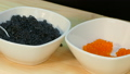 Spread the red salmon caviar in a cup next to 39766002