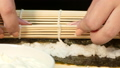 Cook curls sushi roll with stuffing 39766022