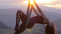 Woman practicing fly-dance yoga poses in a hammock 39854877