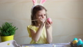 girl paints the Easter eggs 39858293