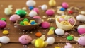 chocolate easter eggs and drop candies on table 39951842