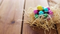 chocolate easter eggs in straw nest on table 39951845