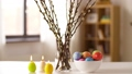 easter eggs, willow and candles burning at home 39951846